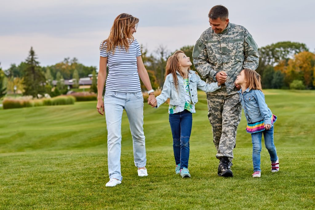Happy Family With Soldier Father Walking Outdoor