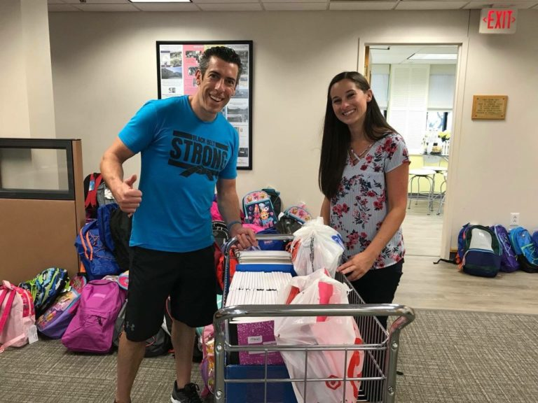 Smiling backpack donation photo