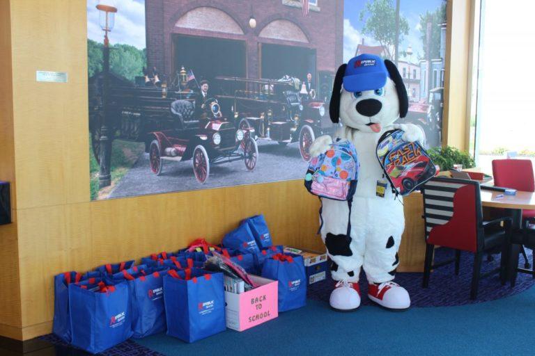 Republic Bank dog holding backpacks