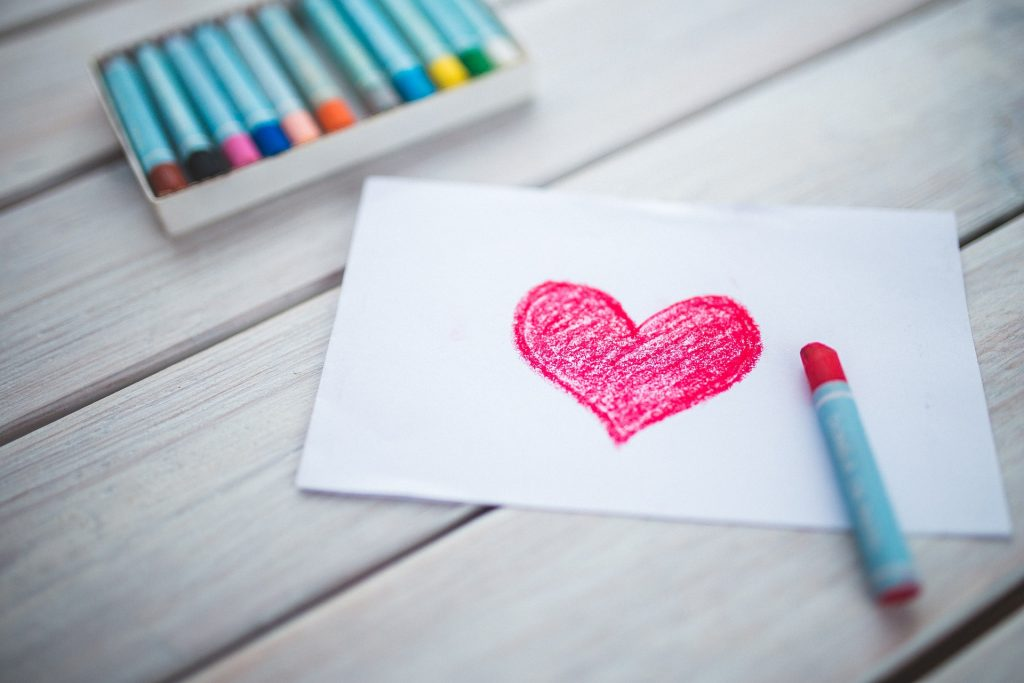 Hand-drawn heart and crayons