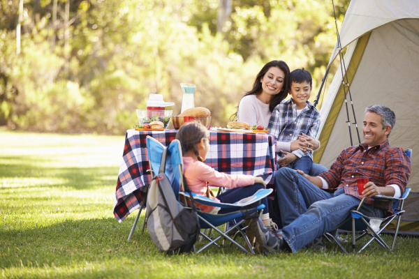 family staying mentally well by taking camping trip together
