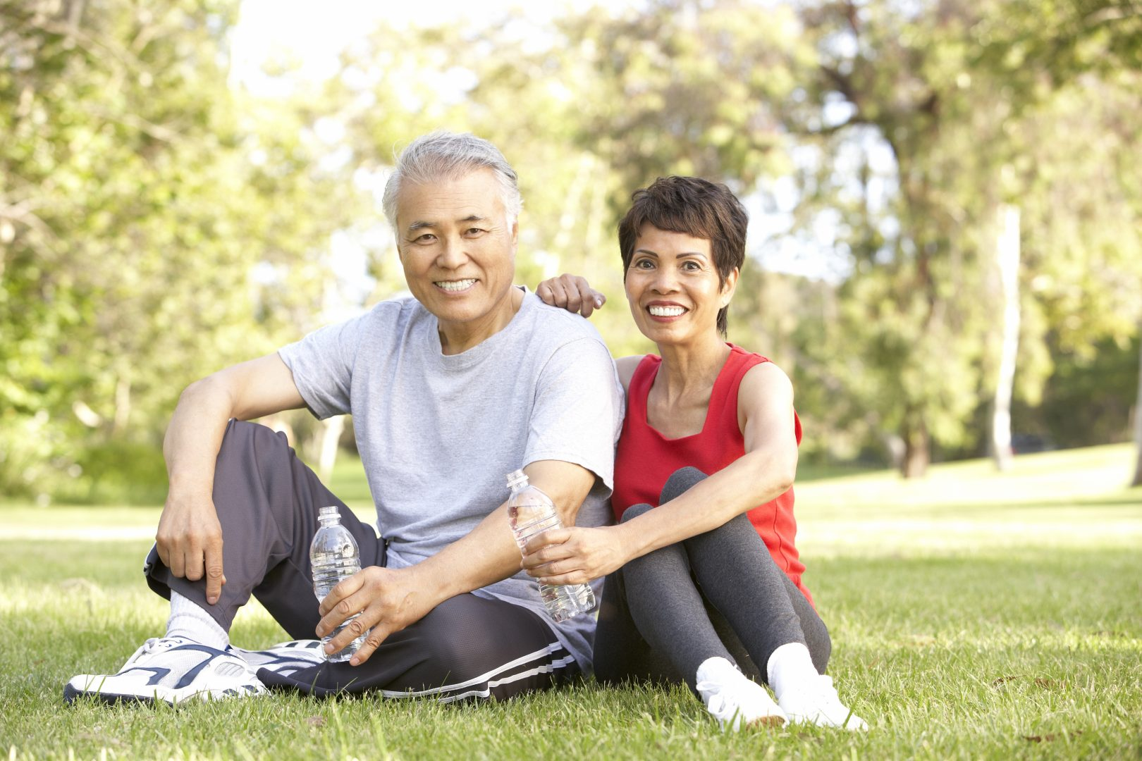 older couple resting at park after exercising