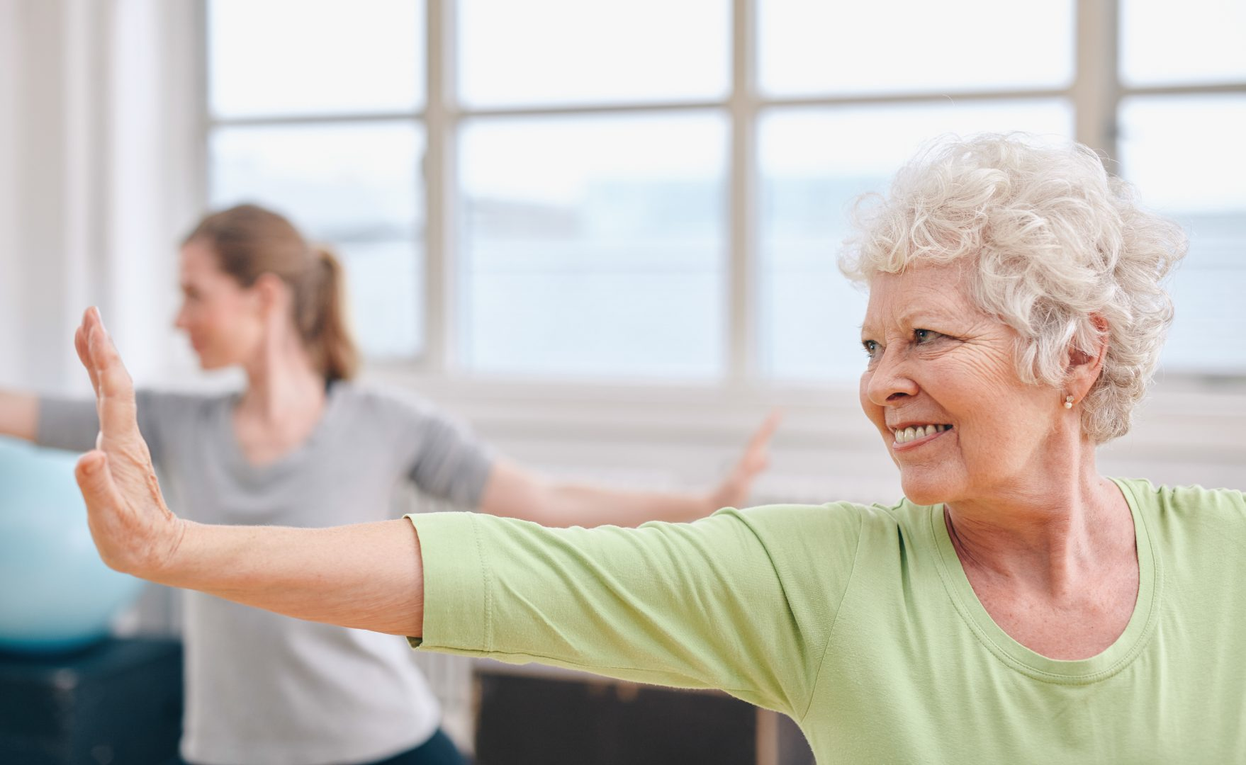 older woman at fitness class