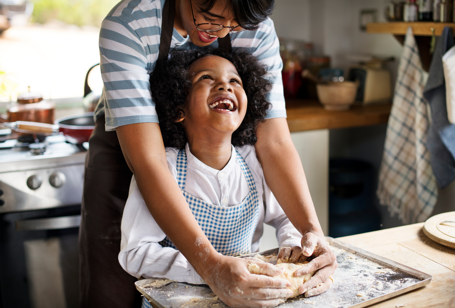 Parent and child happily making dessert for Valentine's day