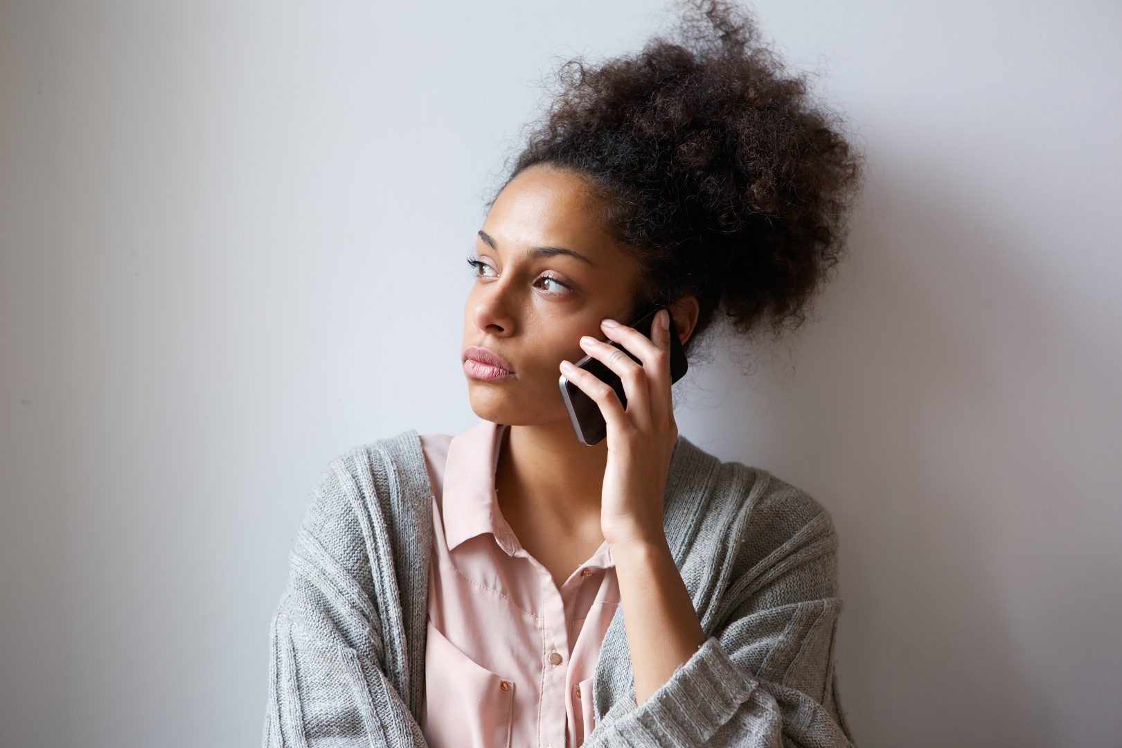 young woman talking on phone for recovery services