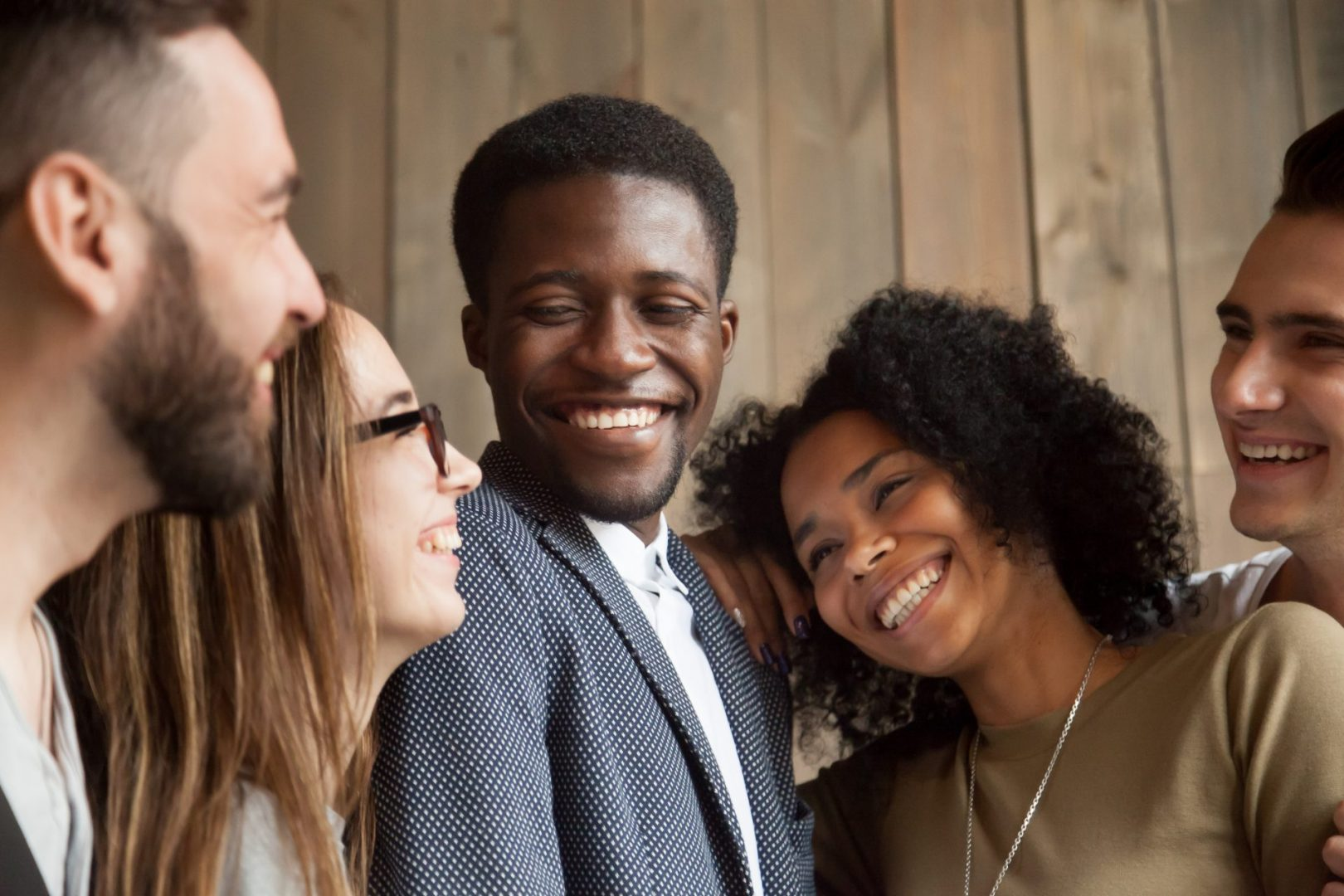 group of friends laughing together - social wellness month
