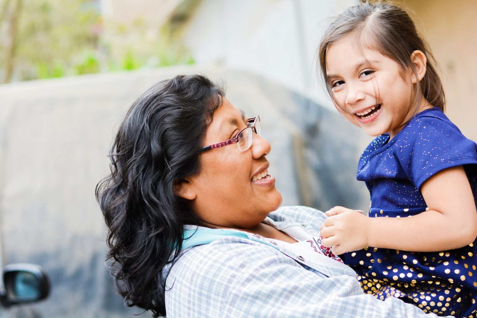 mother and adopted child smiling at each other - adoptive families