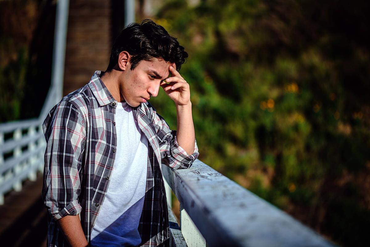 man suffering from summer seasonal affective disorder