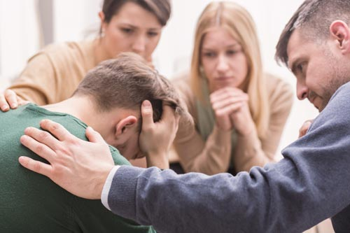 family comforting distressed man overdose awareness