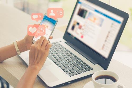 social media on laptop extrovert