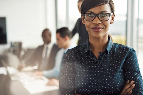 strong black female in workplace with glasses gender equality
