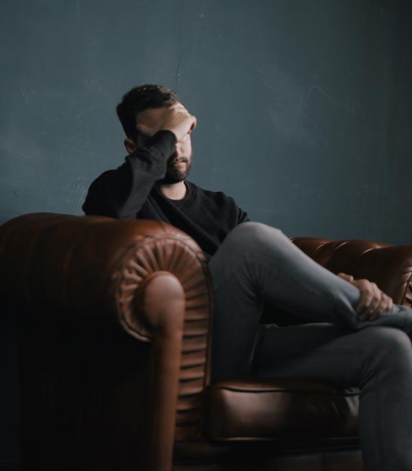 man sitting stressed