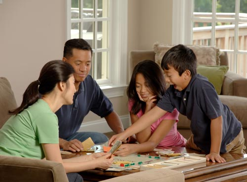 family playing board game winter