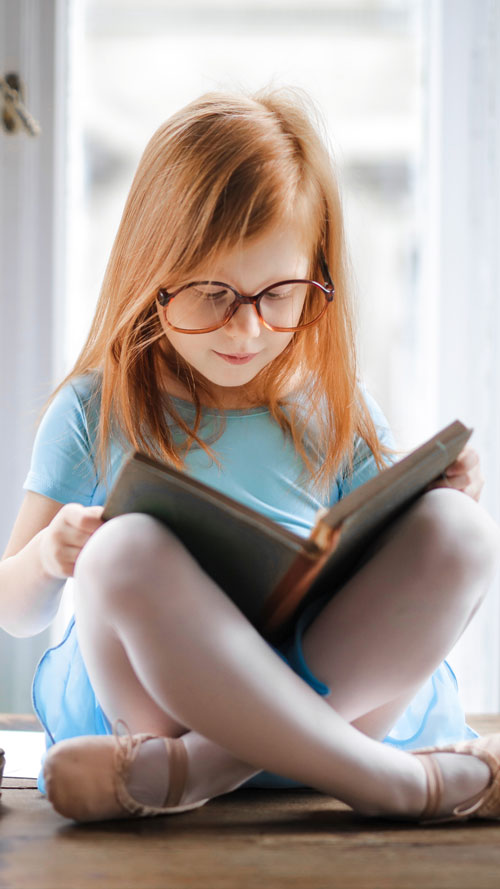 young girl reading book about mental health
