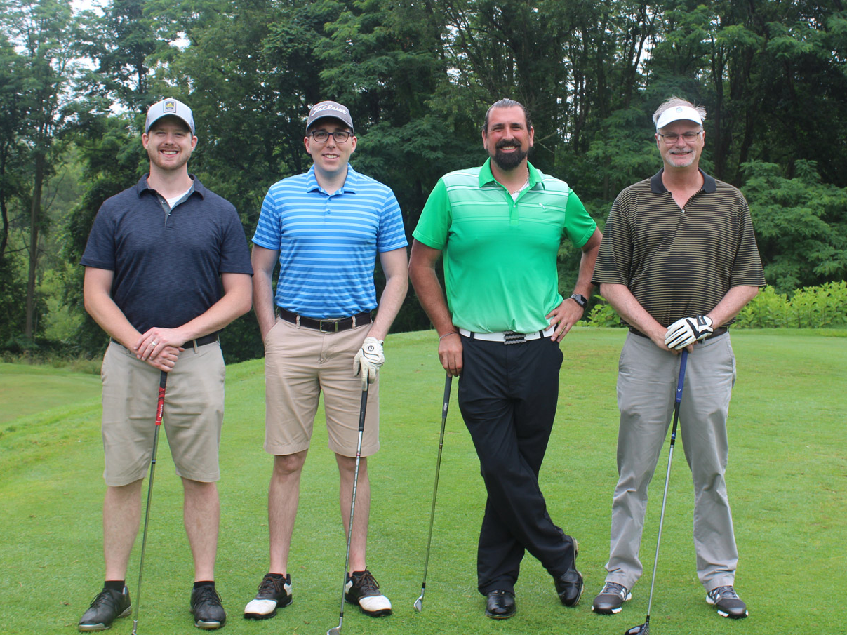 golfers posing at annual golf outing
