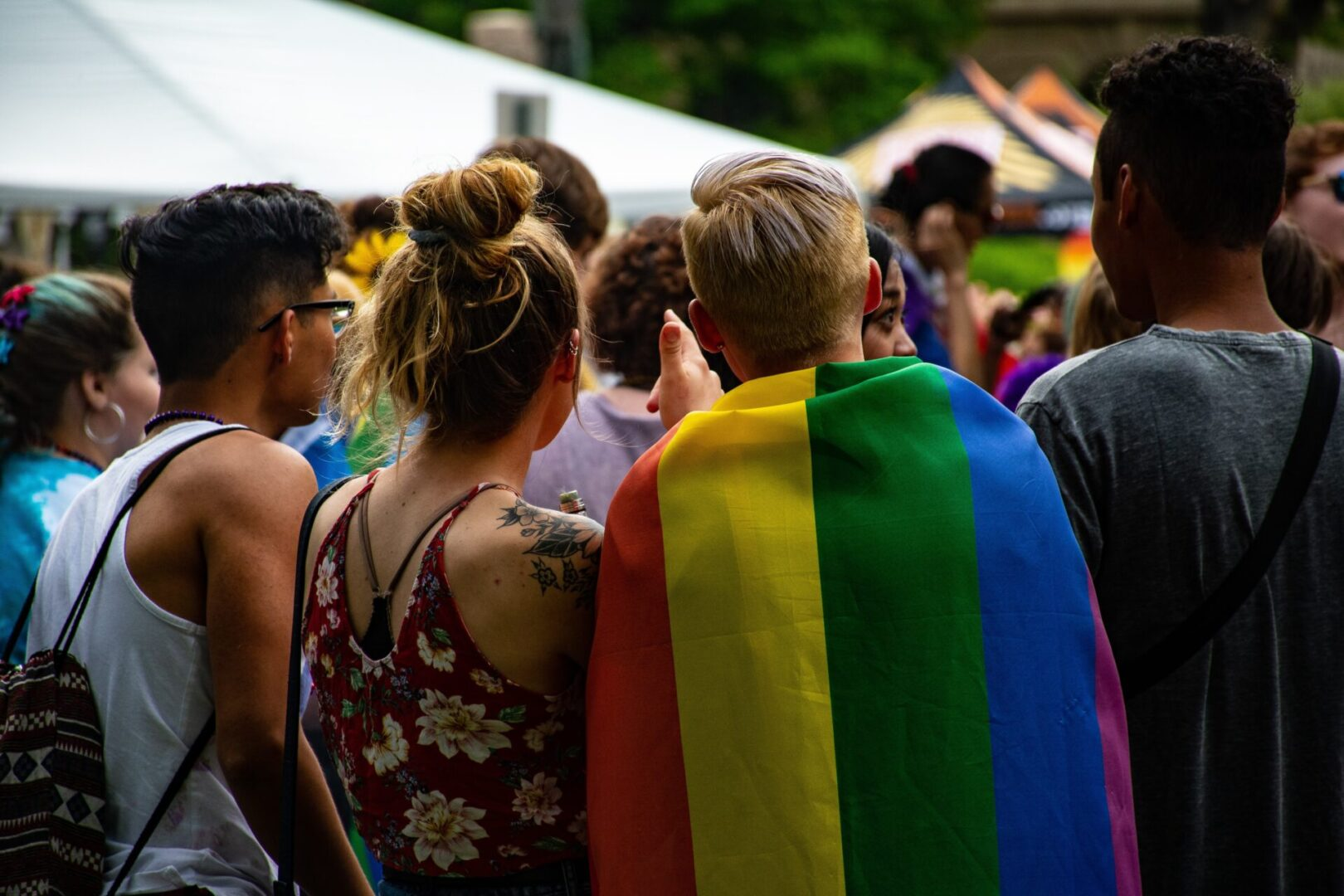 Group standing at a LGBTQ+ Pride event