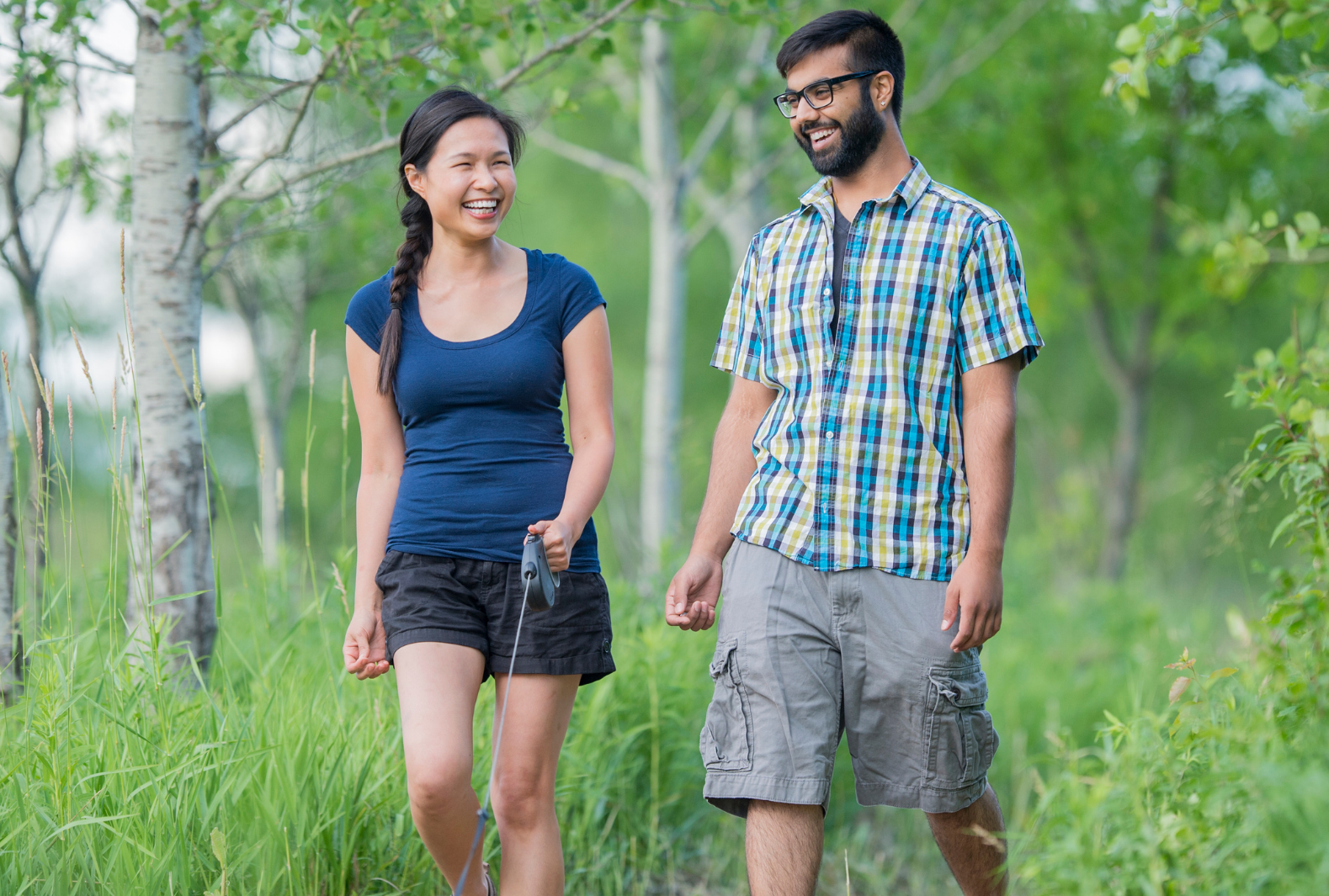 two young adults walking outside together social wellness