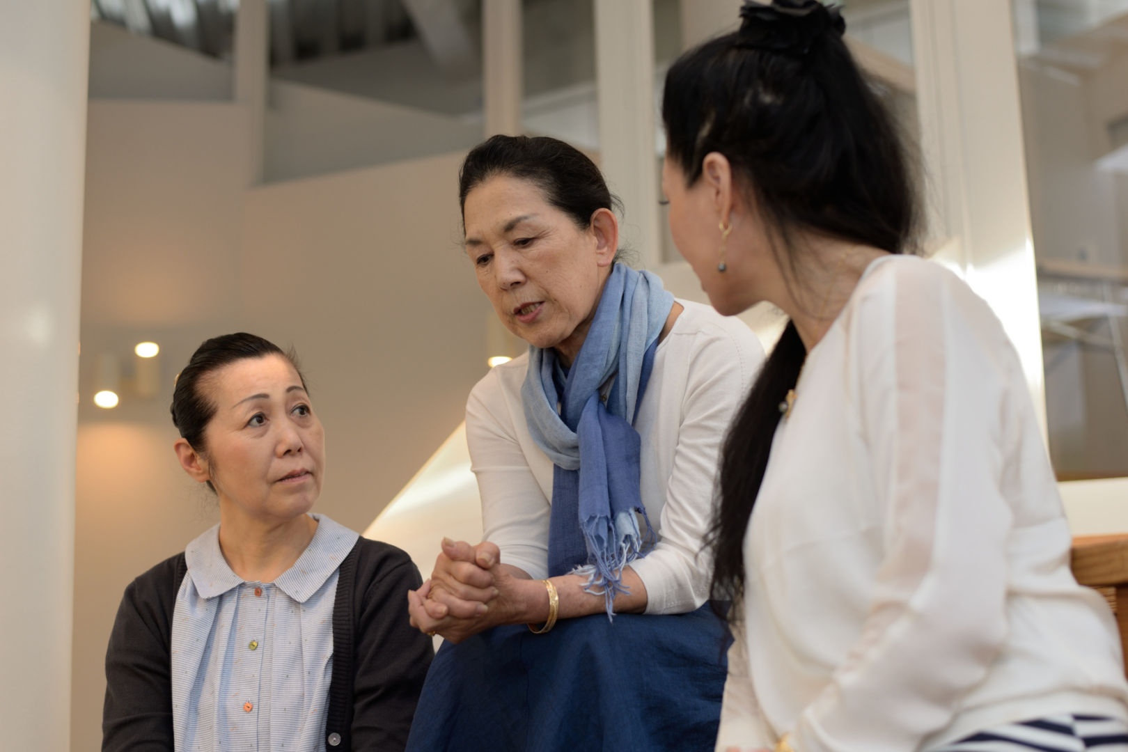 group of three asian women talking suicide prevention