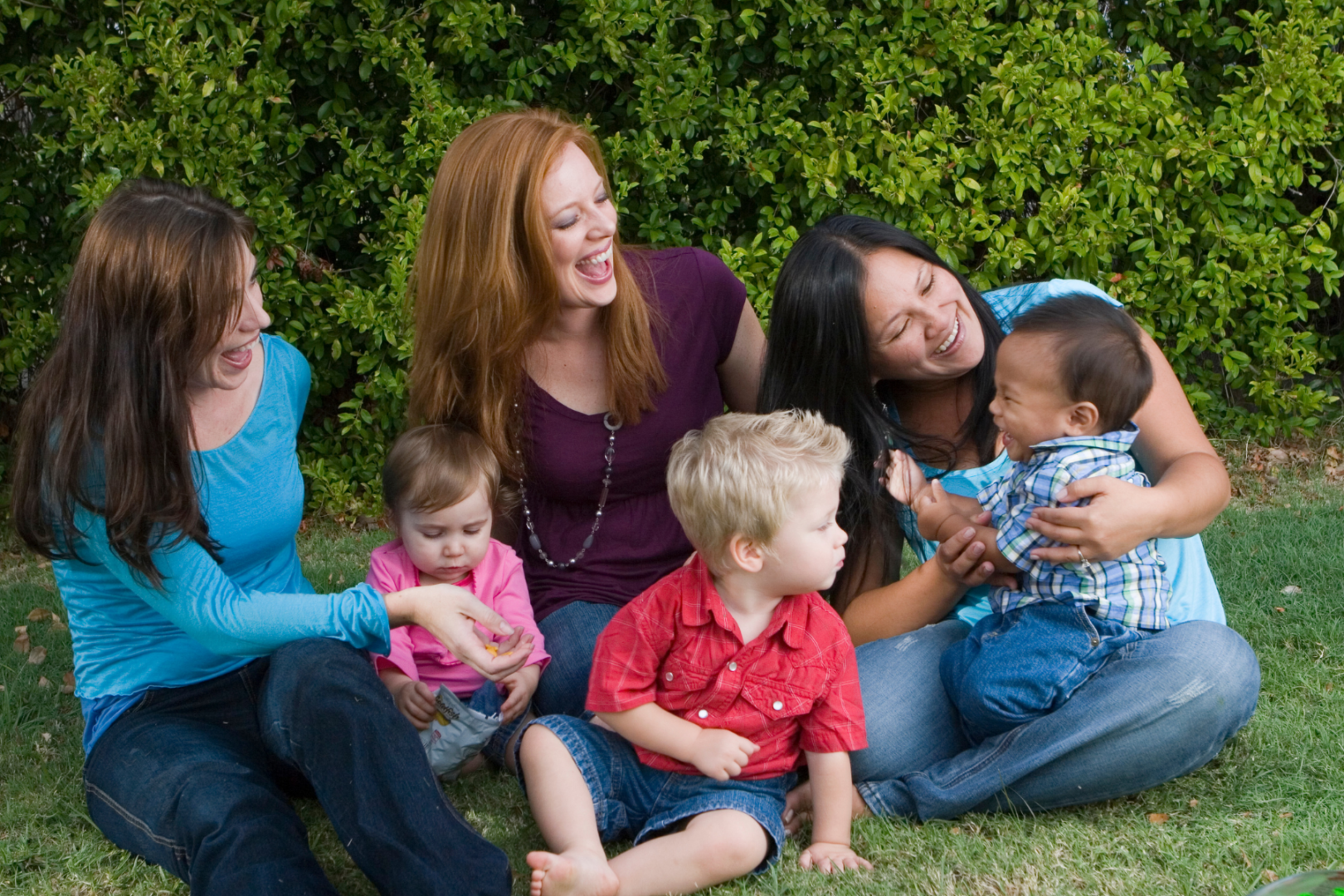 three moms and children talking mom shaming