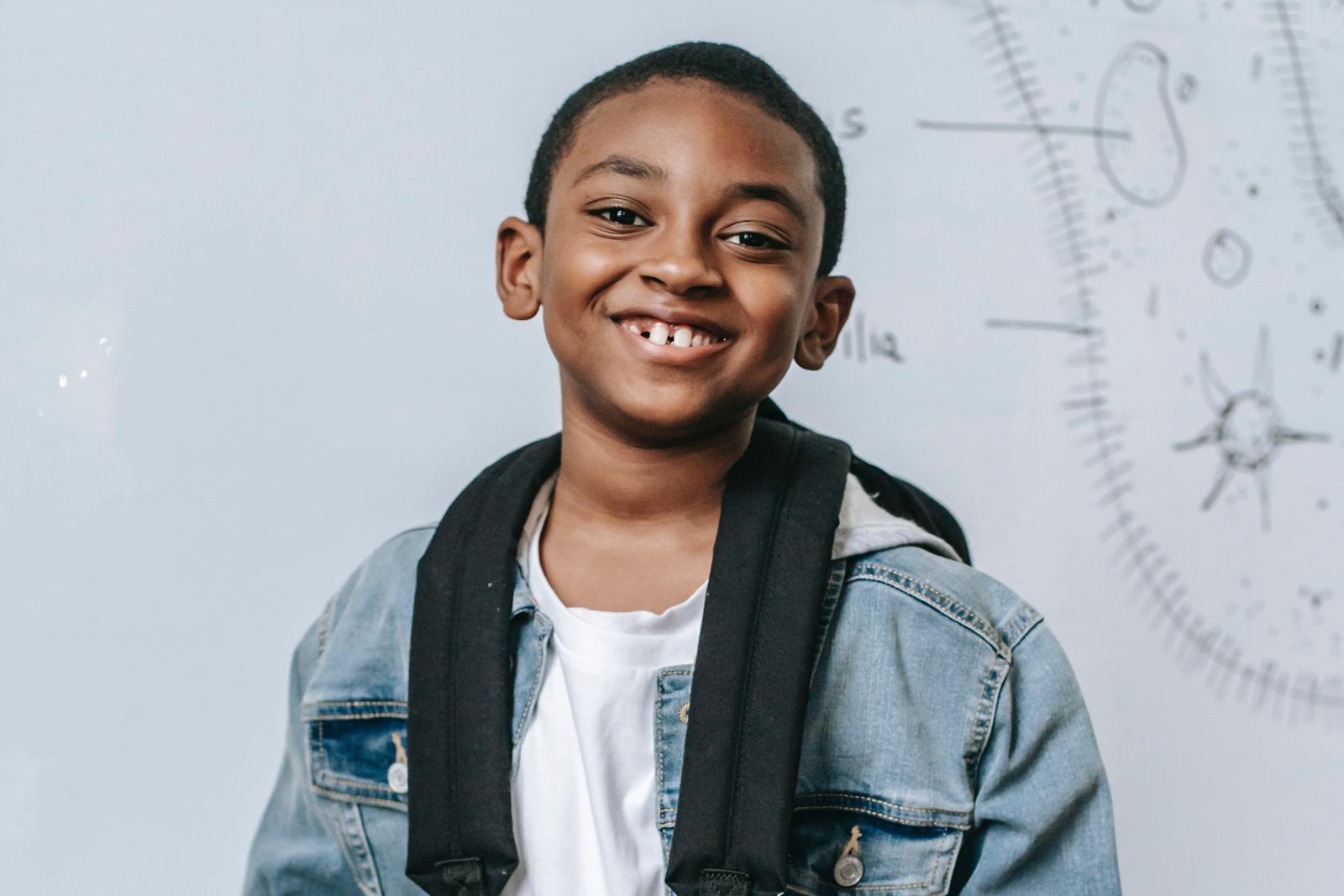 black boy wearing backpack in science classroom
